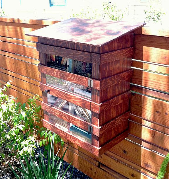 Free library on fence